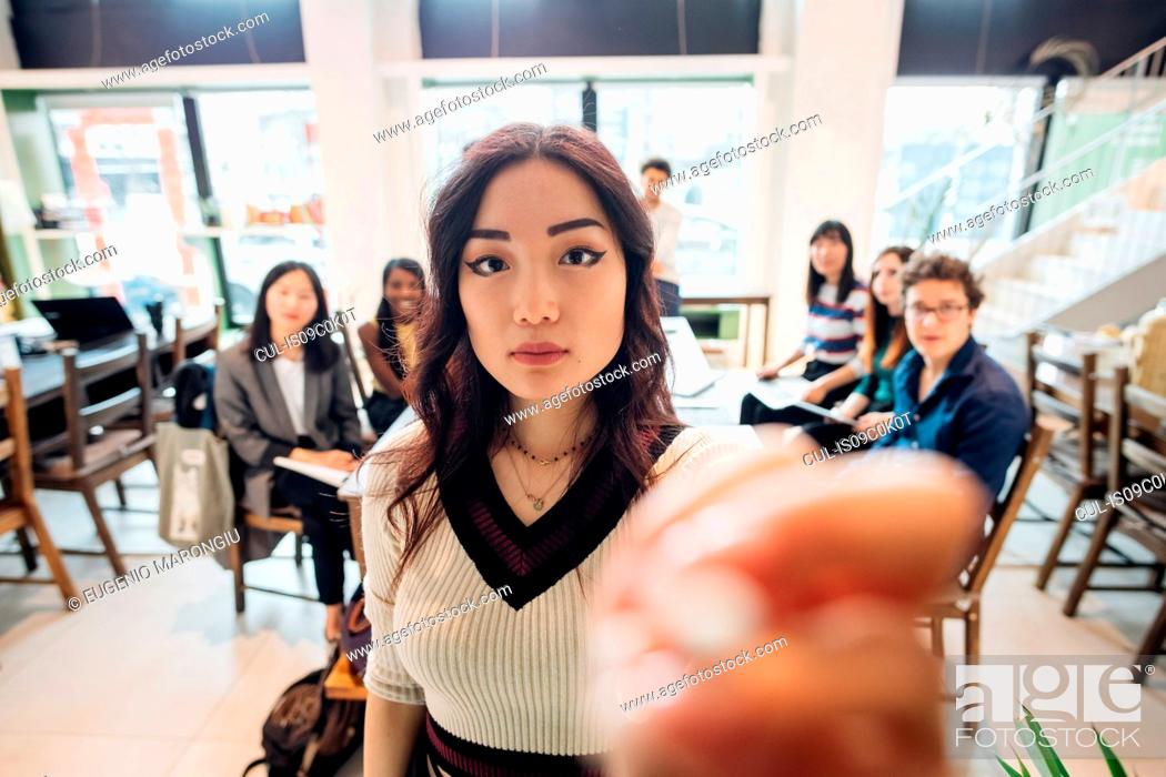 Stock Photo: Young businesswoman preparing for presentation to colleagues.