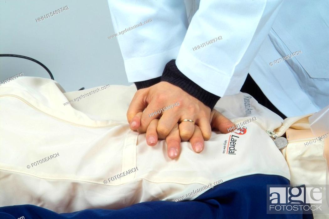 Stock Photo: first aid, doctor, cardiopulmonary resuscitation, cardia massage, artificial respiration, mannequin.