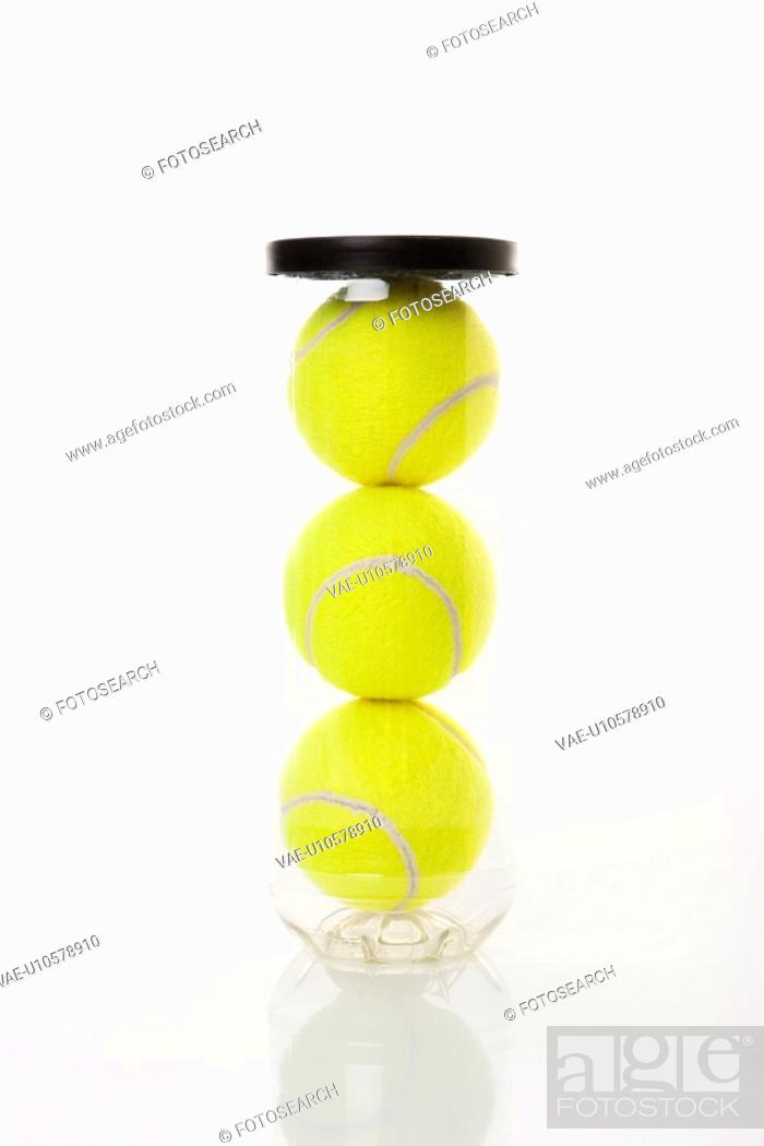 Stock Photo: New tennis balls stacked in plastic container.