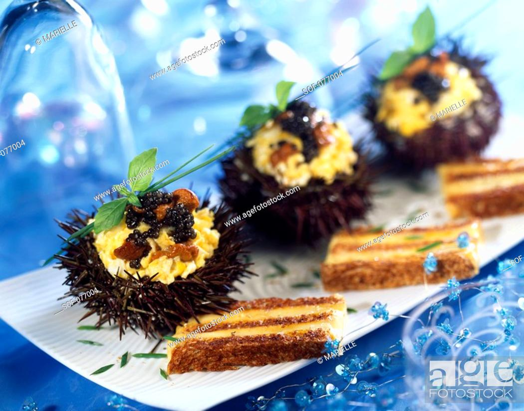 Stock Photo: scrambled eggs with caviar in sea urchin shell.