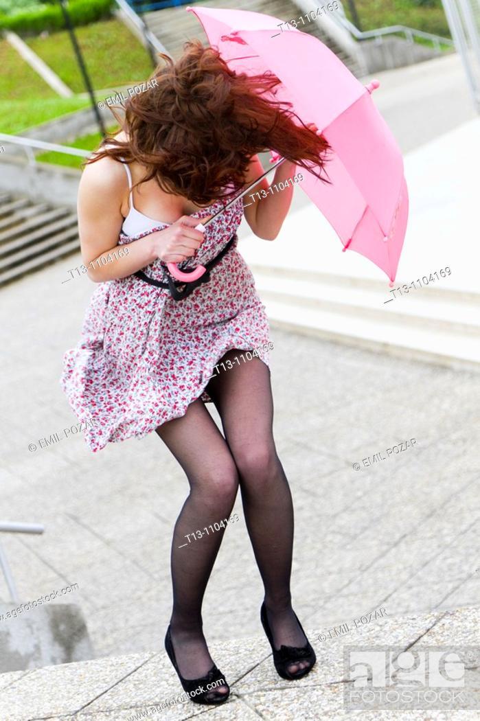 Stock Photo: Protecting under small pink umbrella.