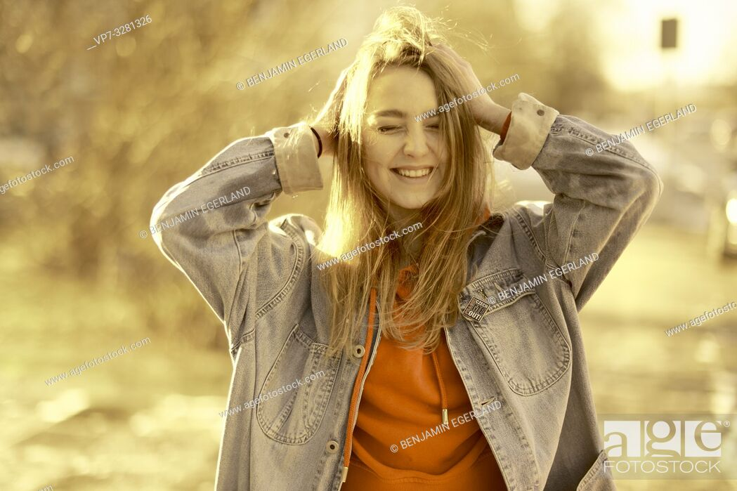 Stock Photo: young woman in sunlight, in Cottbus, Brandenburg, Germany.