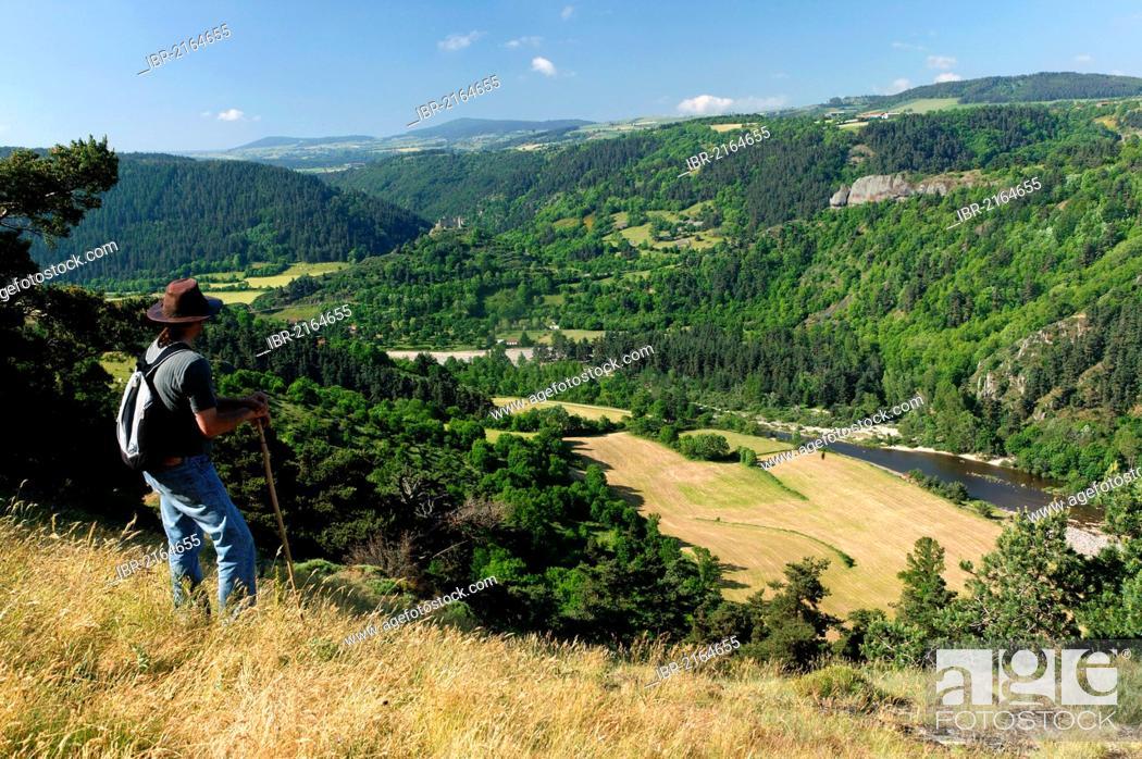 Stock Photo: Hiker in the Loire Gorges near Goudet, Haute Loire, Auvergne, France, Europe.