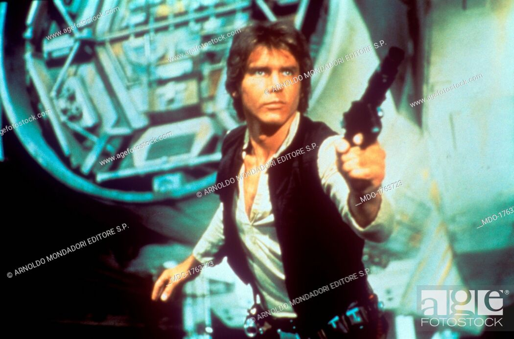 Stock Photo: Harrison Ford drawing a gun. In a scene from George Lucas' epic space opera Star Wars, the American actor Harrison Ford as rebel smuggler Han Solo draws a gun.
