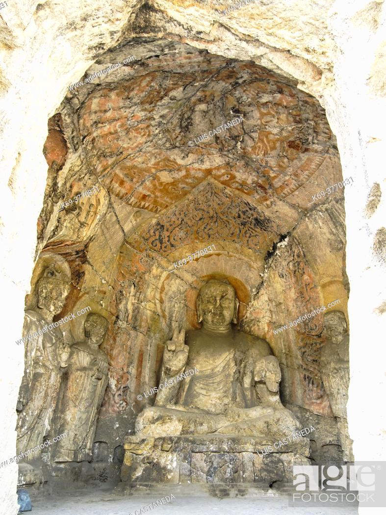 Stock Photo: Amitabha. Main wall of Biyangbeidong Cave. . Dating from Zhenguan Era to Yonghui Era of Tang Dynasty (627-655). . The grottoes were started around the year 493.