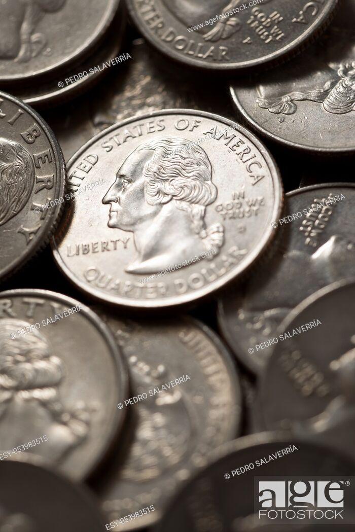 Stock Photo: Quarter dollar coins on a black table.
