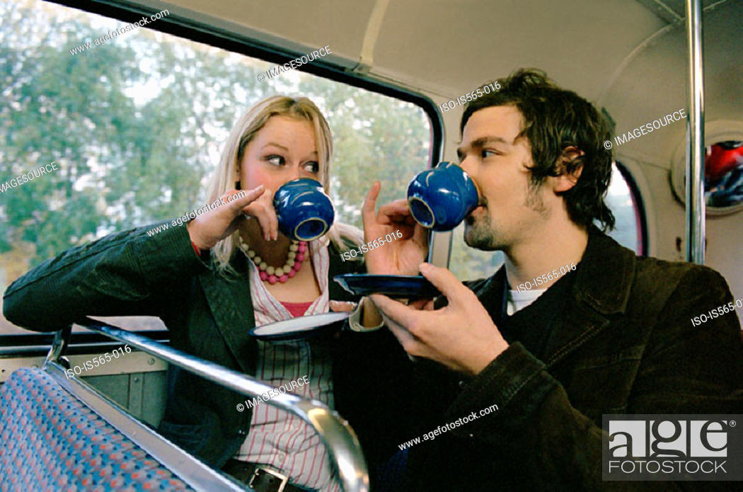 Stock Photo: Couple drinking tea on bus.