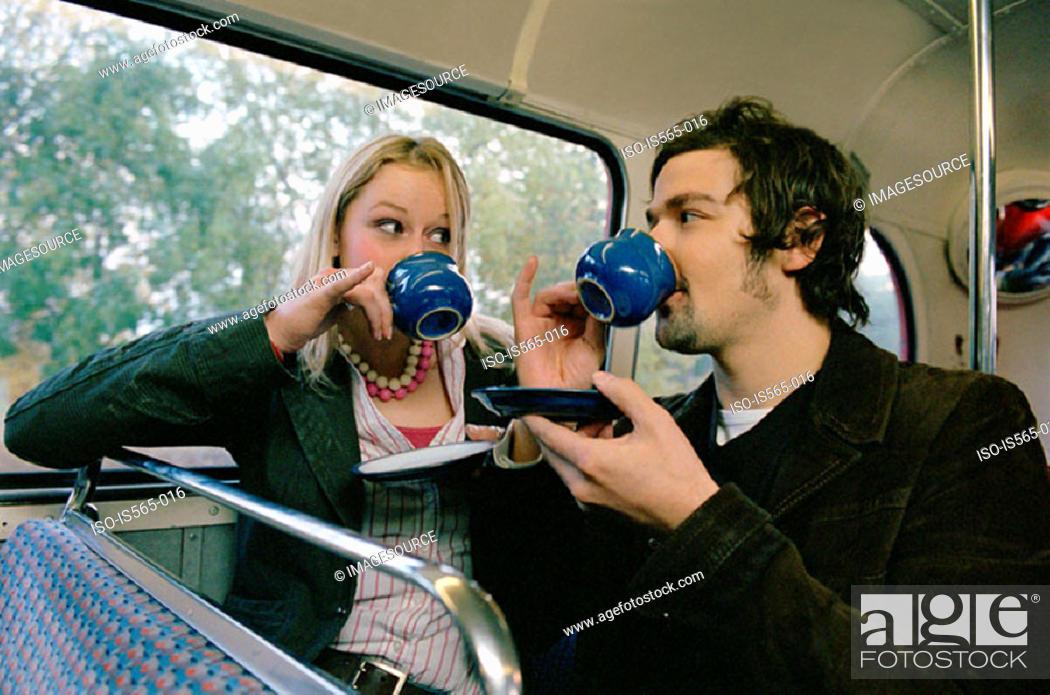 Stock Photo: Couple drinking tea on bus.