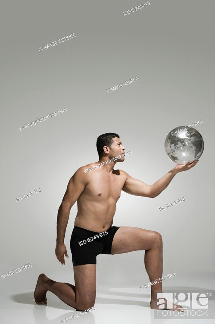 Stock Photo: Man holding a globe.