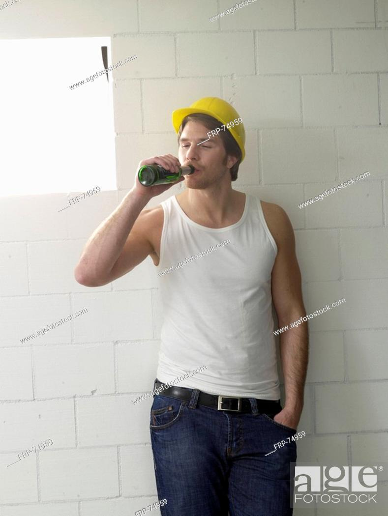 Stock Photo: Construction worker is drinking beer.