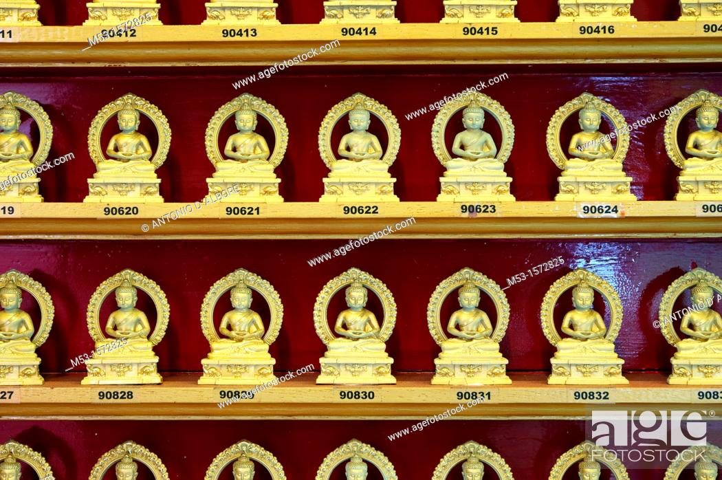 Stock Photo: Numbered golden statues of Buddha while meditating in lotus position  Singapore Buddha Tooth Relic Temple and Museum.