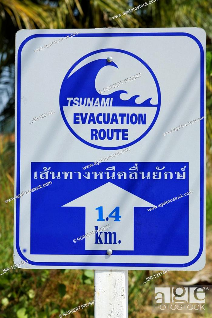 Tsunami warning sign showing escape routes, evacuation route