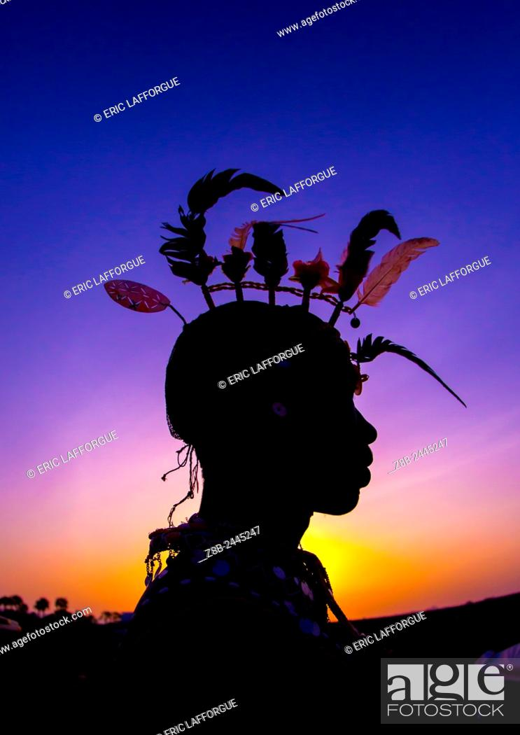 Stock Photo: Silhouette Of Rendille Warrior Wearing Traditional Headwear, Turkana Lake, Loiyangalani, Kenya.