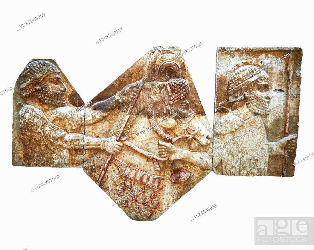 Stock Photo: Stone relief sculptured panel of tributaries. From corridor 10, Inv AO 1433/19899/19895 from Dur Sharrukin the palace of Assyrian king Sargon II at Khorsabad.