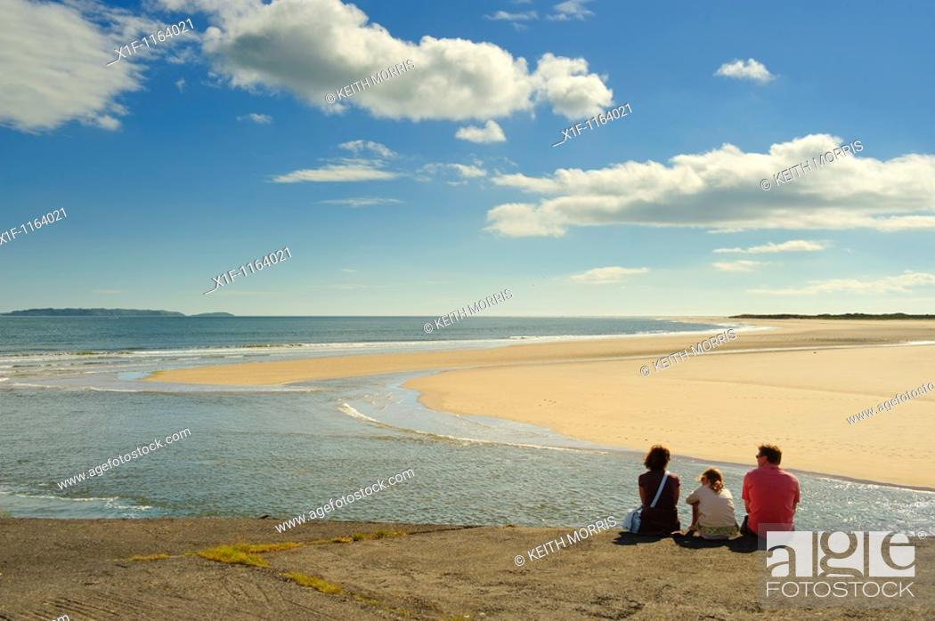 Stock Photo: A family admiring the view on a sunny day at The Millennium Coastal park, Burryport, Carmarthenshire South Wales UK.