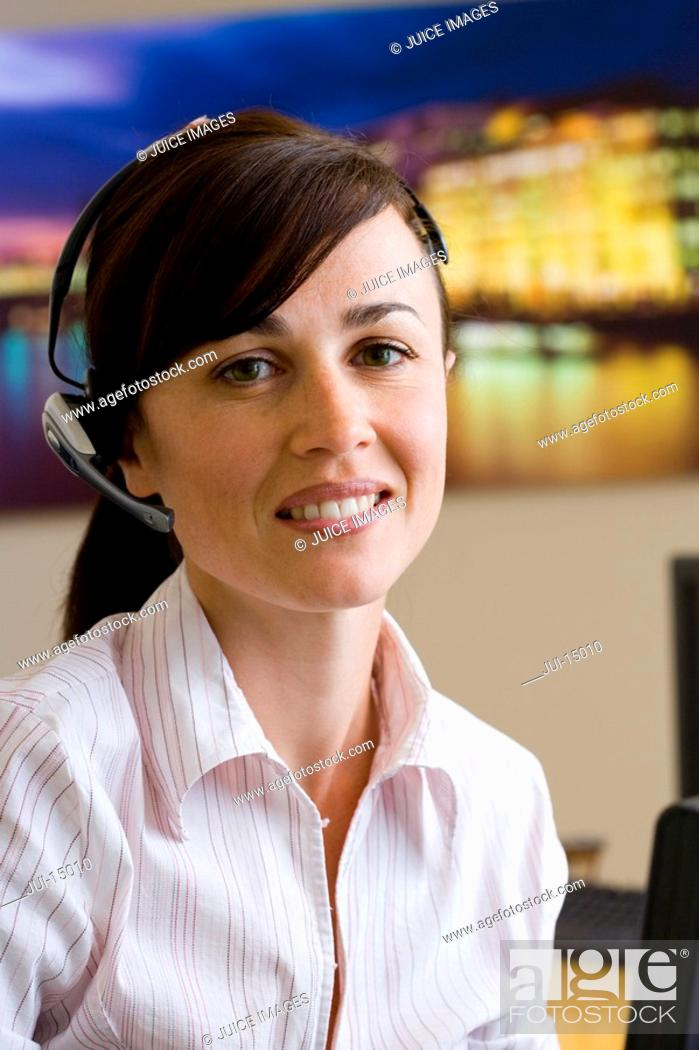 Stock Photo: Receptionist with headset, smiling, portrait.