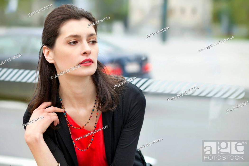 Stock Photo: Close-up of a woman waiting at bus stop.