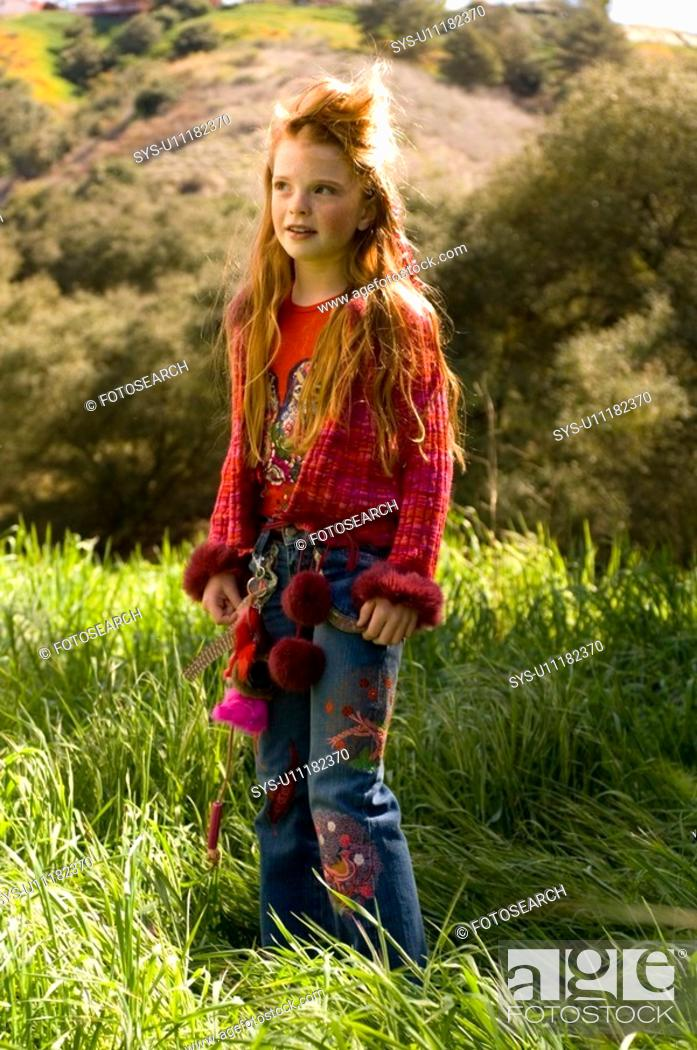Stock Photo: Portrait of young girl outdoors.