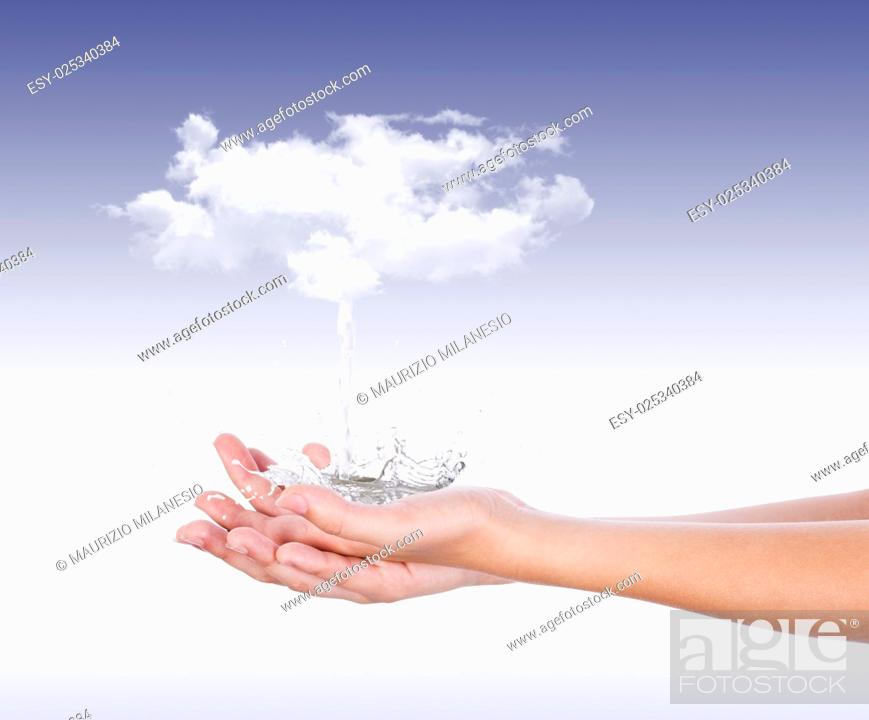 Stock Photo: From white clouds, pouring water on the palms splashing in all directions, in front of a blue background.