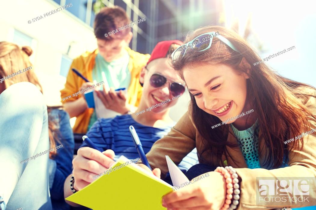 Stock Photo: group of students with notebooks at school yard.