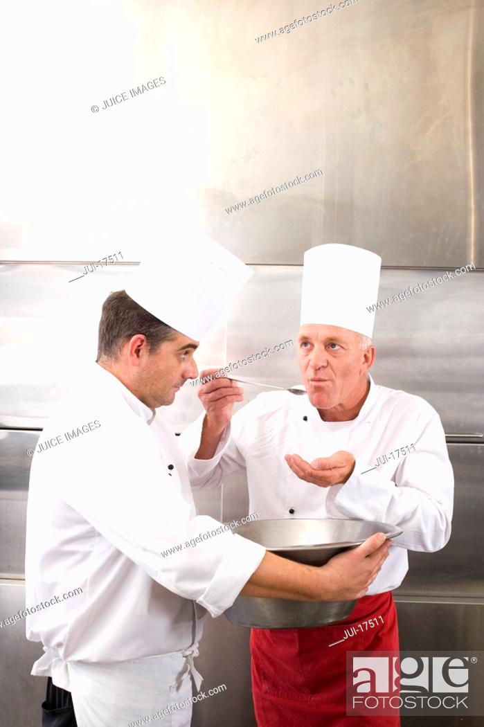Stock Photo: Chefs in commercial kitchen.