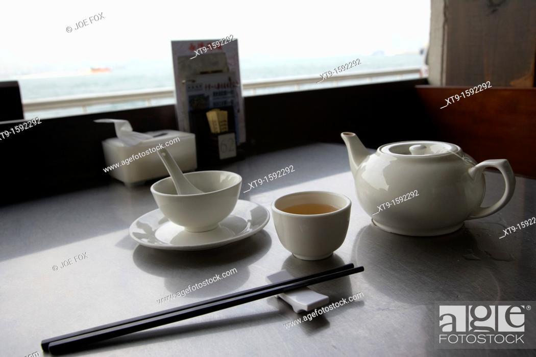 Stock Photo: chinese restaurant place setting with bowl chopsticks chinese green tea hong kong island, hksar, china.