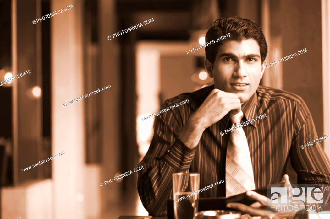Stock Photo: Portrait of a businessman sitting in a restaurant.