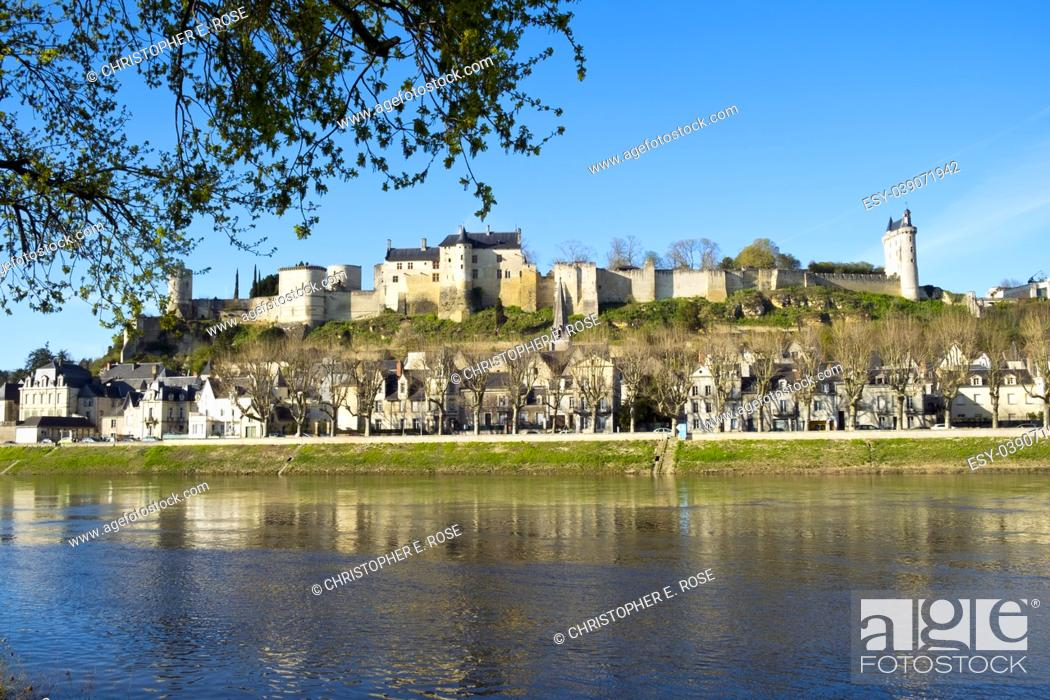 Stock Photo: Chinon town with its chateau on the hill above in spring afternoon sunshine on the banks of the River Vienne, Indre-et-Loire, France.