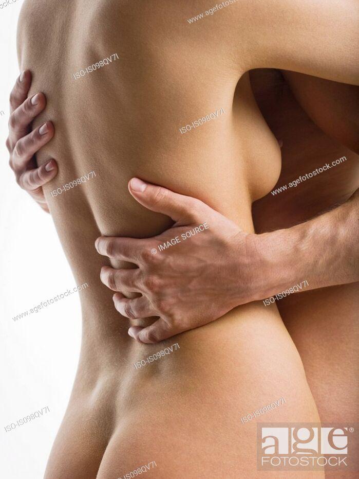 Stock Photo: Nude couple hugging.