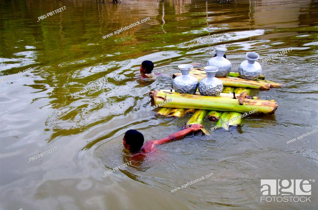 Stock Photo: Empty pitchers carrying by a banana raft to collect driking water aftermath of a devastating cyclone The cyclone Aila swept over the coastal areas of Bangladesh.