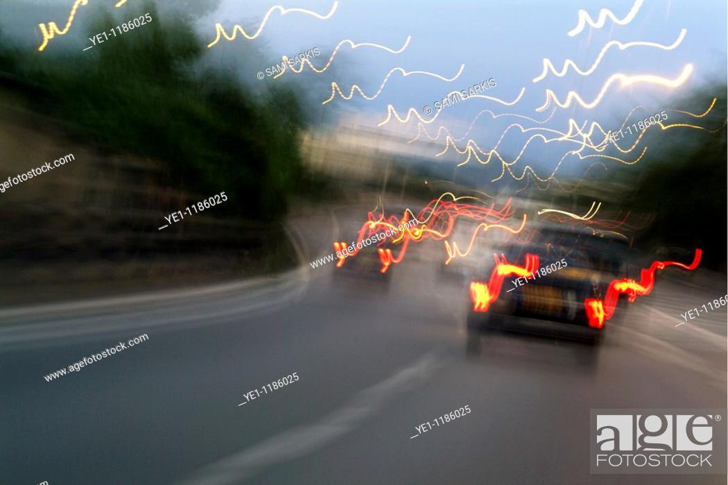 Stock Photo: Cars moving on a highway as seen through a blurred windscreen, Paris, France.