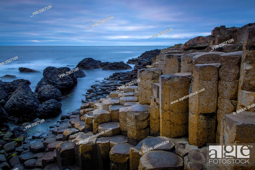 Stock Photo: Twilight over the Giant's Causeway along the northern coast, County Antrim, Northern Ireland, UK.