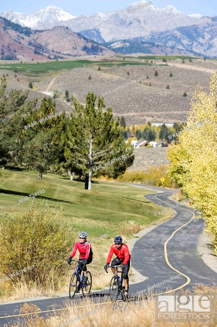 Stock Photo: Couple road biking, Sun Valley, Idaho, USA.