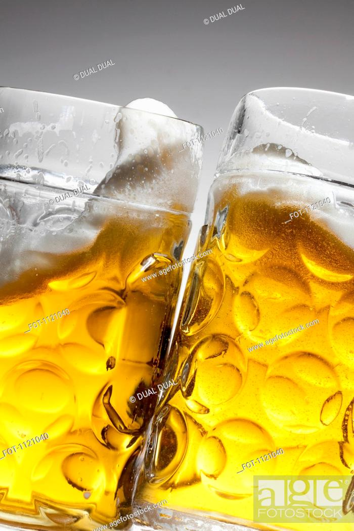 Stock Photo: Toasting with two glasses of beer.
