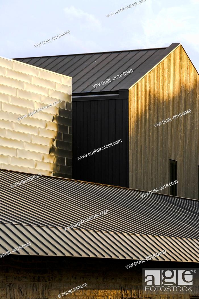 Detail of the black wood panels and metal cladding  Isabel