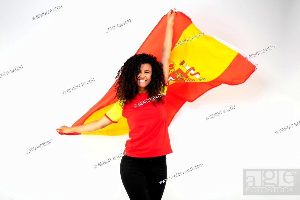 Stock Photo: Portrait of a young supporter of the Spanish team wearing the national flag.
