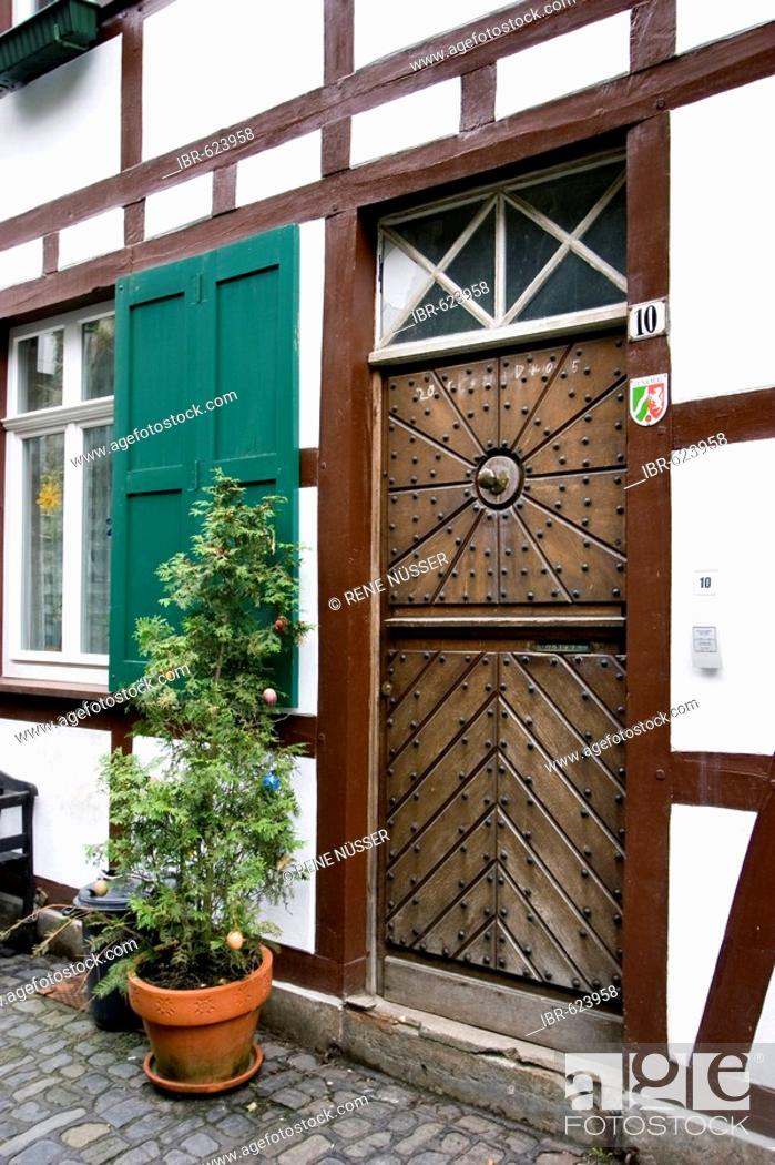 Stock Photo: Wooden door of a Fachwerk house, protected landmark, Monschau an der Eifel, Aachen, North Rhine-Westphalia, Germany, Europe.