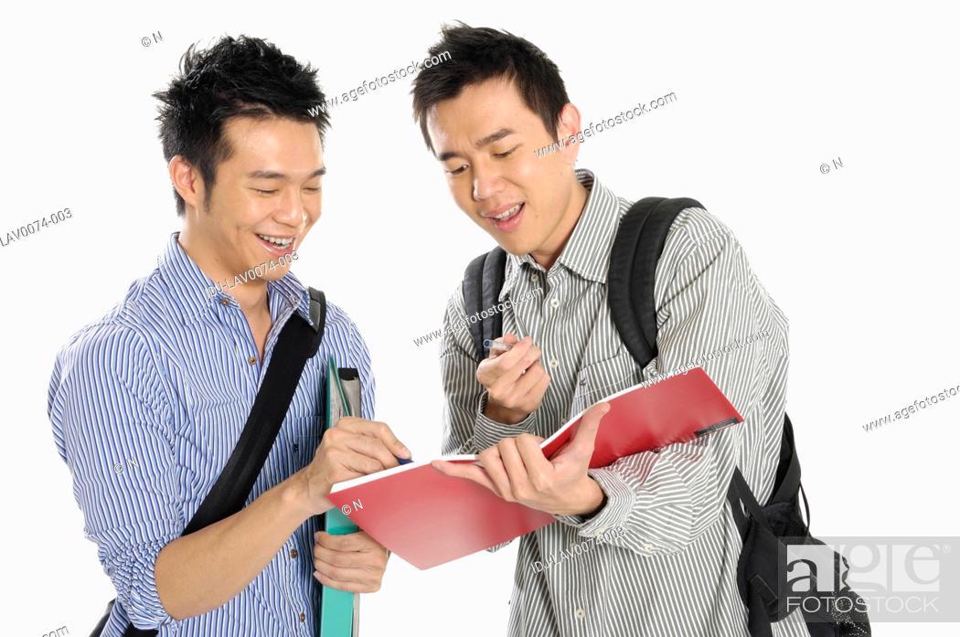 Stock Photo: Male university students studying together.