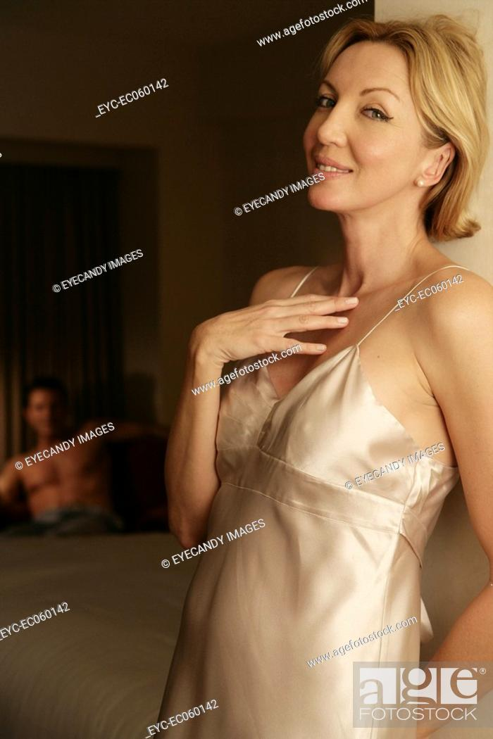 Stock Photo: Mature couple in a bedroom.