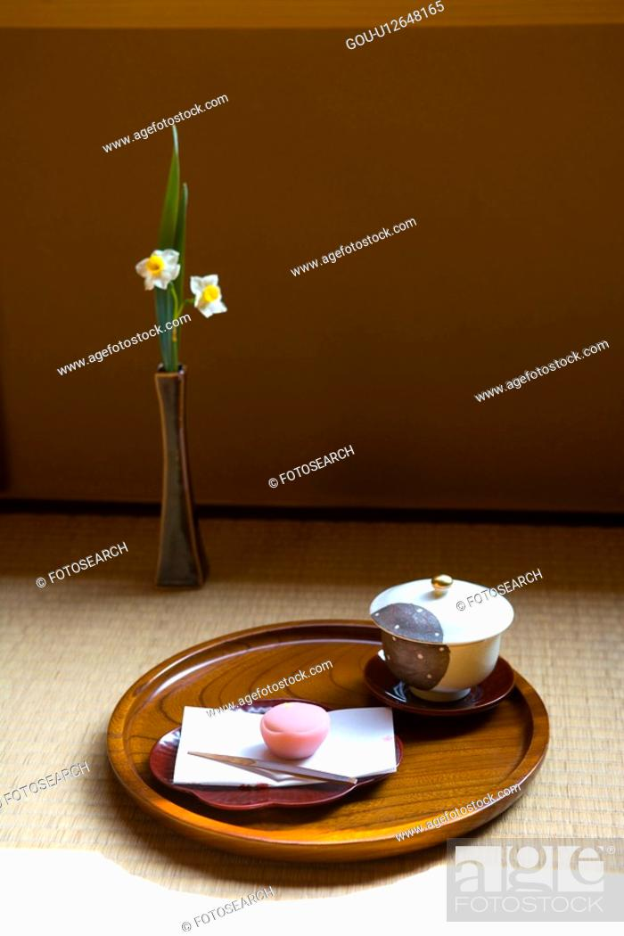 Stock Photo: Wagashi and a cup of Japanese tea on a tray, high angle view, Japan.