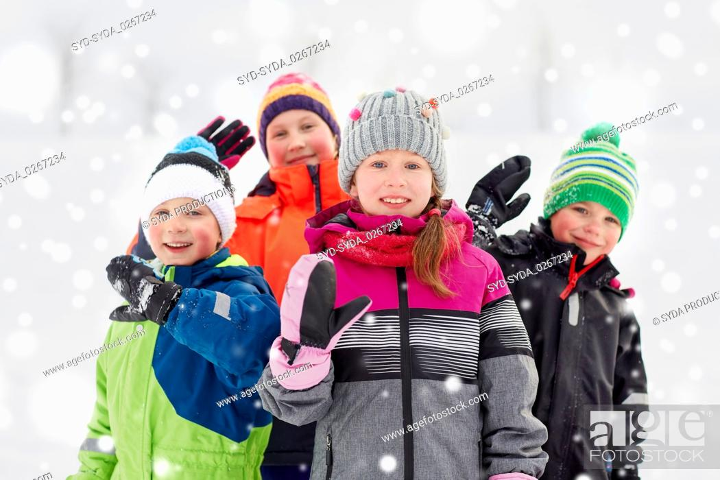Stock Photo: happy little kids in winter clothes outdoors.