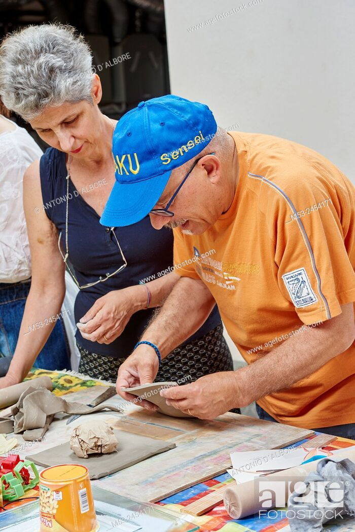 Stock Photo: Amateur artists while modeling clay to obtain raku ceramics.