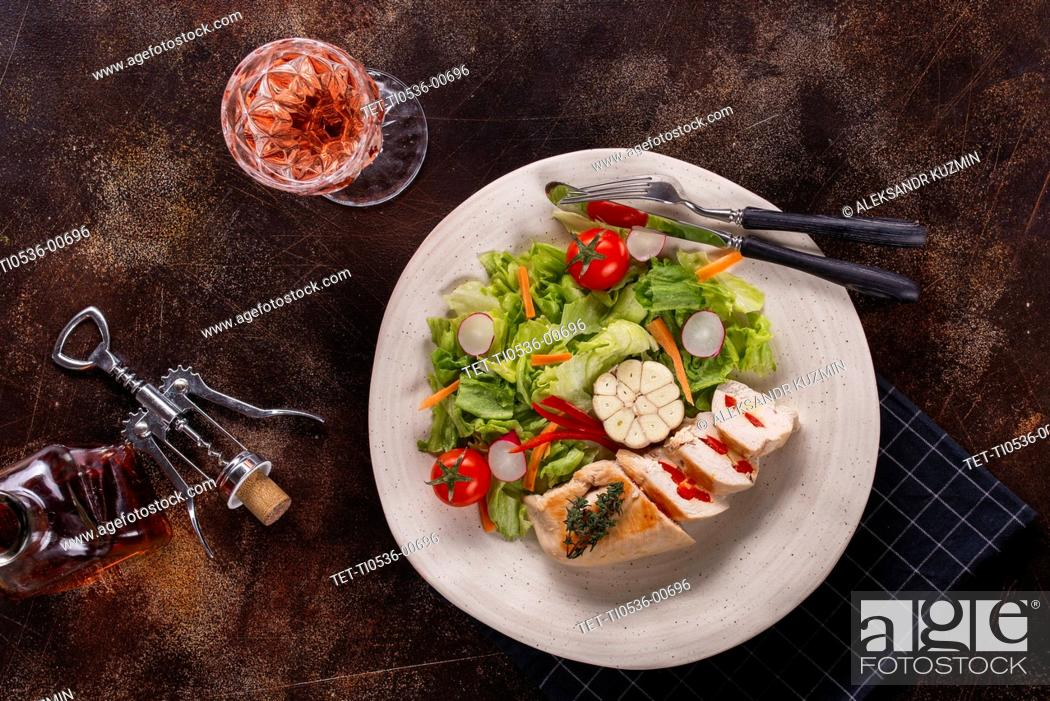 Stock Photo: Lunch of chicken and salad with rose wine.