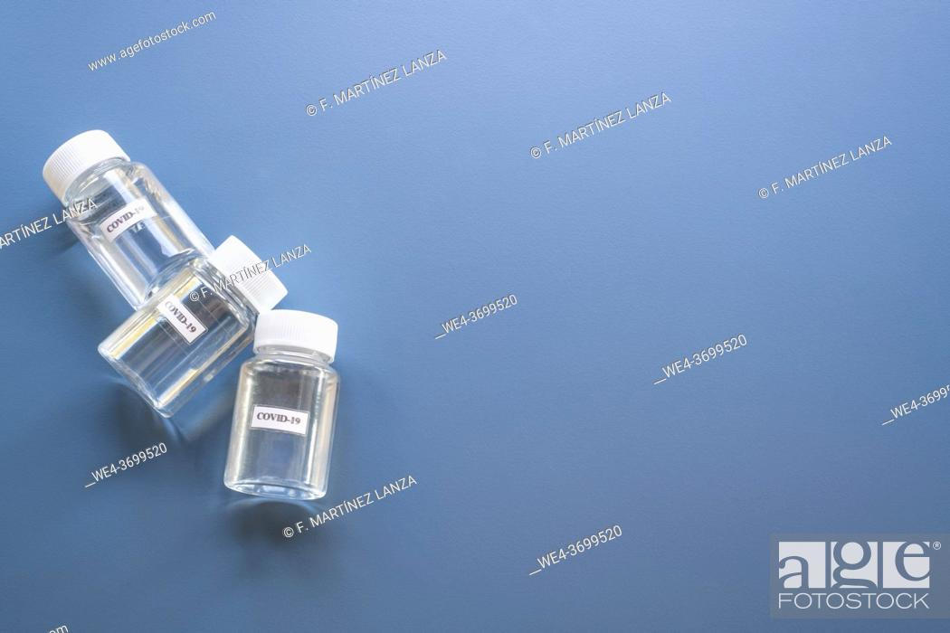 Stock Photo: Plastic canisters with covid-19 vaccine.