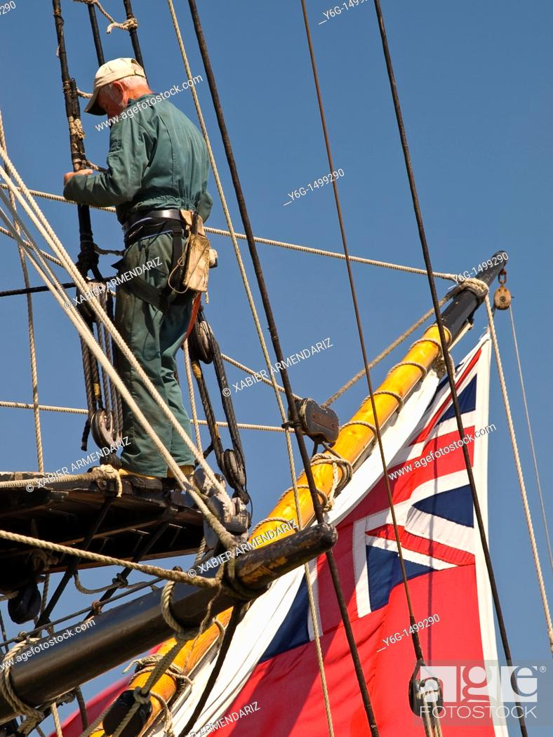 Stock Photo: Old english sailor repairs the rigging in the mizzen mast  Vannes, Bay of Morbihan, Brittany, France, Europe.