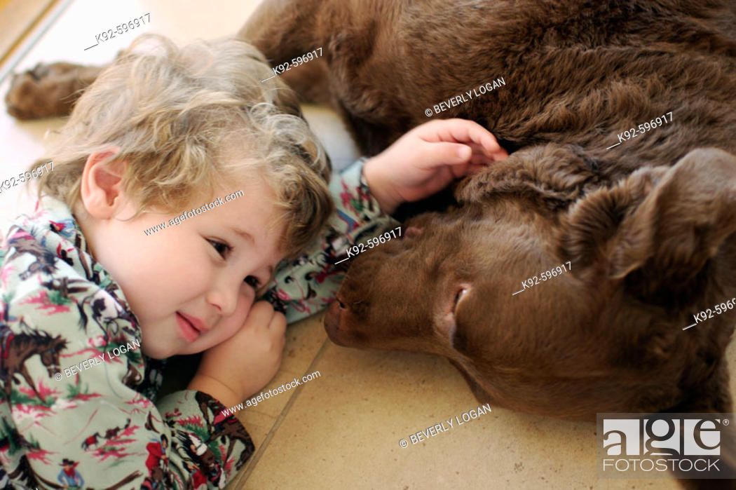Stock Photo: Three-year-old boy and dog.