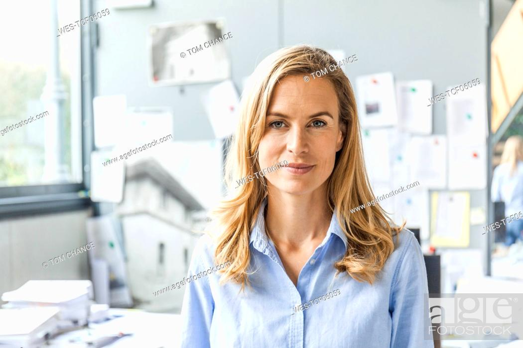 Stock Photo: Portrait of confident woman in office.