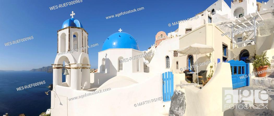Stock Photo: Greece, View of classical whitewashed church and bell tower at Oia.