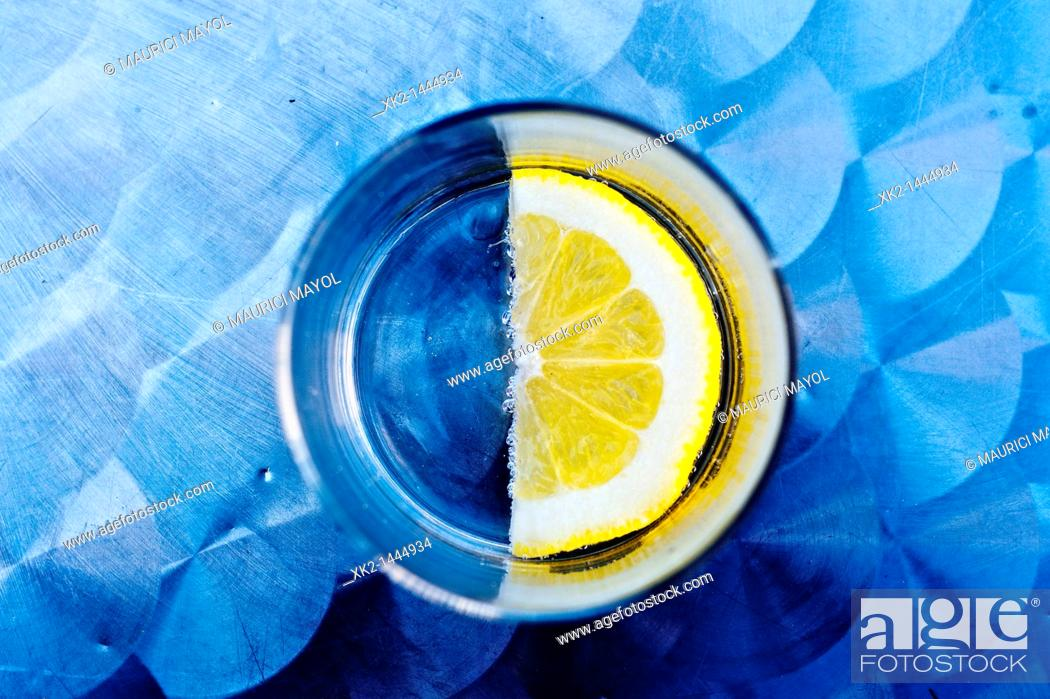 Stock Photo: Half slice of lemon.