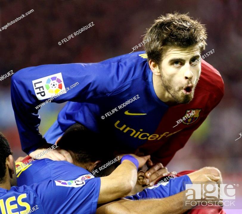 b2371dcb818 Stock Photo - Spanish League 2008-09 (november 29, 2008): Sevilla FC vs. FC  Barcelona. Estadio Ramón Sánchez Pizjuán. Gerard Piqué celebrates a goal  with ...